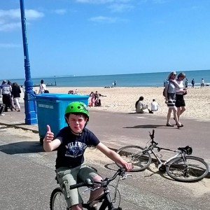 Freddie on his bike after finishing his 14 mile ride for charity