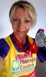 Marathon 2015 - Hannah Gray proudly displays her marathon medal