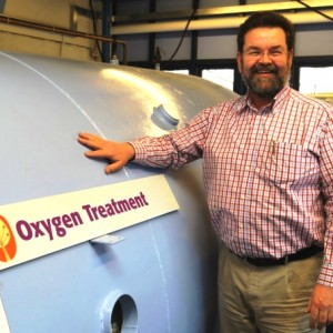 Mark Boscher, CEO, with the oxygen chamber