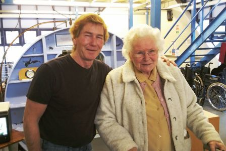 Roger Devereux, Oxygen Chamber Operator from HMSTC with Dorothy Brightman standing in front of the Oxygen Chamber.