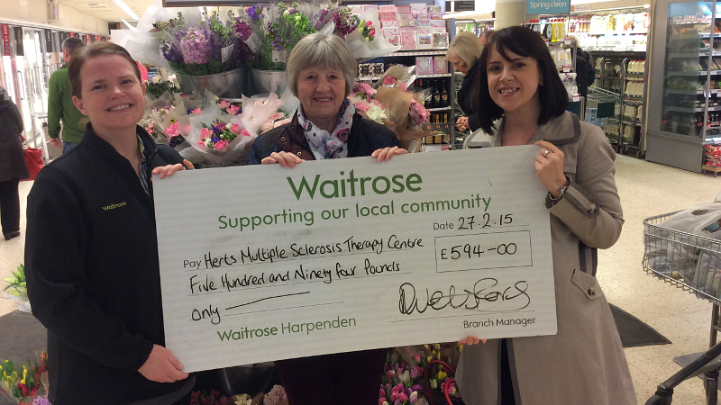 Fundraising cheque being handed-over to Herts MS Therapy Centre by Waitrose Harpenden
